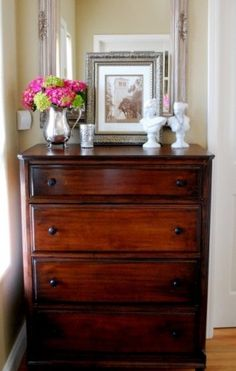 A beautiful dresser or chest in the entry (even if your entry is just a hallway) can be a great place to stash gloves, hats, leashes and spare change. It could even be a good place to charge your phone and camera.
