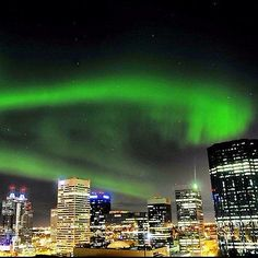 The Aurora Borealis ( or Northern lights ) are spotted over Downtown Edmonton, Alberta Mon nite.