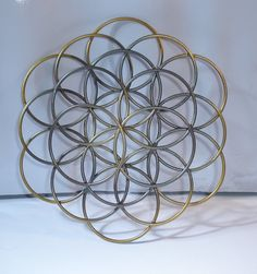 4.5 3D Flower Of Life Wall Art Air Brushed by InspirationMagician, $33.00 - could totally spray paint this a more brilliant gold and put it over a dark plum silk sheet hung as a tapestry for that royal look