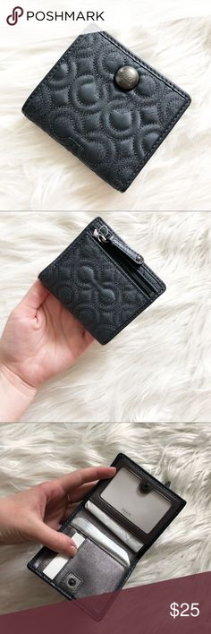 NWT Mini Coach Wallet an amazing small little wallet in perfect new condition! no flaws at all! the perfect size to fit in any sized bag x no trades Coach Bags Wallets