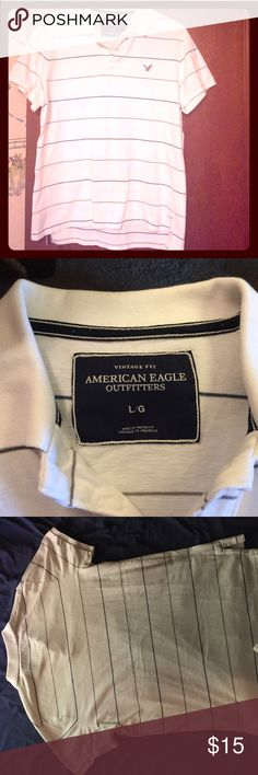 Comfy polo shirt from American Eagle. White with small blue and tan horizontal pin stripes. Grey American Eagle logo. Vintage Fit size L.  Gently worn American Eagle Outfitters Shirts Polos