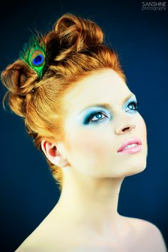 Gorgeous peacock themed bridal make-up and hair / photo by sanshinephotography.com