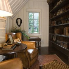 Library nook with leather chairs. Perfect.