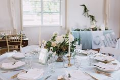Blue linens, wedding reception, table setting, vintage candles, gold frames, barn reception, september wedding, gold chairs, white chairs, wedding inspiration