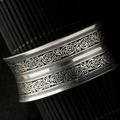 Engraved Miao Silver Bangle (Concave) from the Starfish Project.  Please check out their jewelry and take a look at the wonderful work they do for exploited women.