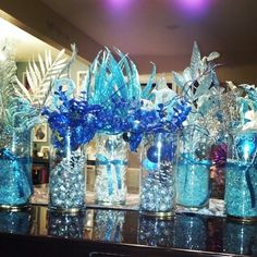 Frozen inspired centerpieces! Bought everything 80% off at Michaels after Christmas! #Frozen #winterwonderland