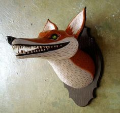 I could totally attempt something like this, except maybe an extinct mammal or something. Love both taxidermy and faux, but it also looks a bit like Oaxacan carving.