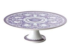 A curling French floral pattern in delicate periwinkle with light golden touches endows this pedestal cake stand with a graceful aesthetic. Delicious treats will look even more delectable when displayed on this table-making piece. #LuxDeco #Design #Homeware