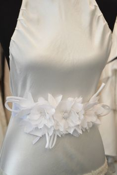 A personal favorite from my Etsy shop https://www.etsy.com/listing/502679646/white-organza-satin-wedding-sash-white