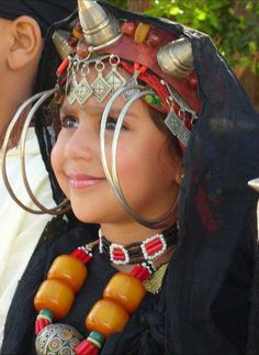 Moroccan Berber Amazigh Girl. She knows a thing about accessorizing.  Silver jewelry.