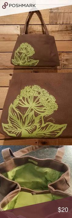 "Crabtree & Evelyn natural fiber canvas tote Crabtree & Evelyn natural fiber canvas tote in brown with a green silkscreen floral design. 12"" long x 8"" high x 5 1/2"" wide.  Very roomy for a smaller bag. Green interior. Snap closure. Crabtree & Evelyn Bags Totes"