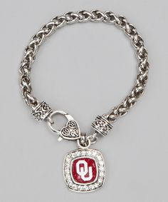 Garnish wrists with a splash of stylish school spirit. Fitted with a commemorative collegiate charm and handy lobster clasp, this sleek silver alma mater bracelet acts as a fashionable accent and treasured token. Chain: 7.5'' longPendant: 0.75'' W x 0.75'' HSilver / brass / zincMade…