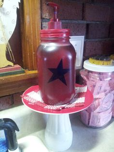 Dish-soap dispenser made from a mason jar. I cut a star out of contact paper and stuck it on the jar. Then i sprayed the jar and a lotion nozzle-pump red. I made a hole in the lid and fit and glued the nozzle in it. After the paint was dried I removed the contact paper star. It's sitting on a pedestal made from a painted glass glued under a painted saucer.