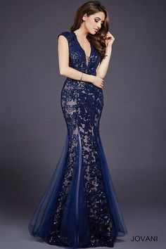 Beautiful floor length embellished mermaid evening gown with nude underlay features cap sleeves and plunging v neckline.