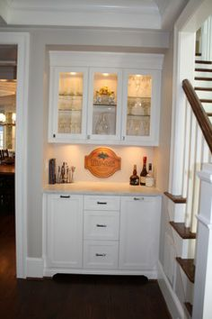 Glass doors and glass shelves for bar…use kitchen cabinets for bar?