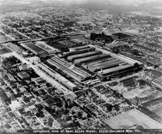 Aerial view of the West Allis Works, Allis-Chalmers Manufacturing Company, and surrounding neighborhoods. West Allis Wisconsin, Milwaukee Wisconsin, Allis Chalmers Tractors, Industrial Machinery, Old Factory, Farmer's Daughter, Historical Society, Aerial View, Vintage Ads