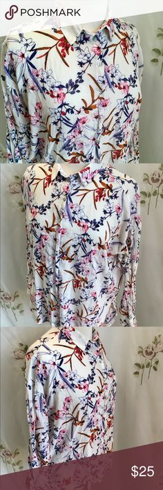 "H & M Button 100% Cotton Button Down Shirt / 6 H & M Button Down Loose Fit Shirt White w/Pink Flowers. 100% Cotton.  This shirt is light weight and is in like new condition.   Shoulder 9"" Sleeve 18"" Bust 46"" Back 24"" Length 27"" H & M Tops Button Down Shirts"