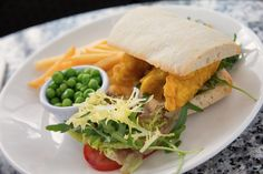 From the children's menu! Fish gougon sandwich with peas and fries.  Kids menu. Kids Meal. Lunch time idea.