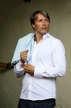 Mads Mikkelsen. Only he could manage to look attractive with a random towel slung across his shoulder!