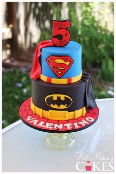 Super hero cake featuring Superman, Batman and Spider-Man :)  Www.hotmamascakes.net