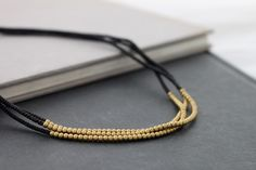 3 Strand Black Brass Necklace by XtraVirgin on Etsy, $12.00 - Just use skinny leather cording and small gold beads