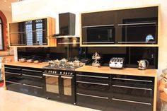 black kitchen - Szukaj w Google Black Gloss Kitchen, Black Kitchens, Liquor Cabinet, Storage, Wood, Table, Furniture, Google Search, Home Decor