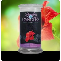 Fresh from the tropics! As sweet and fragrant as the flower it is named after. Floral notes of hyacinth, jasmine and gardenia blend with a hint of light musk and amber to round out this intoxicating blend. Island Hibiscus Candle   Infused with natural essential oils, including Orange, Patchouli, Violet Leaves, Jasmine, Neroli, Mimosa and Sandalwood. Full size 21oz scented candle 100% all natural Soy candle  Burns for 100 to 150 hours.  Includes a surprise piece of jewelry in every candle.