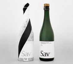 hile Sweden may not strike you as a typical wine producer, the Scandinavian country has some interesting contributions to the world of wine.  Sav Sparkling Wine isn't borne of grapes, but a birch sap that is pressed in the virginal wine-making region of Jämtland.  Sav's bottle and identity is inspired by the very tree from which this wine is created, the white birch.  After the cover is peeled away, the label is a minimal white with solid black lettering.