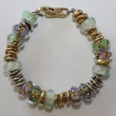 A  beautiful spring day bracelet by a very artistic member of our Trollbeads Gallery Forum.