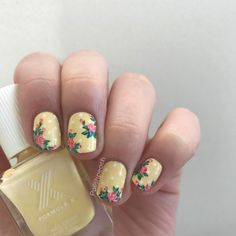 "Super cute nails with roses and polka dots Base color is Formula X ""Lively"""
