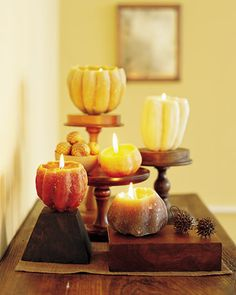 Making candles using hollowed-out squash shells.