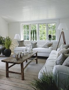 Hardwood floors and rustic wood furniture contrasted by the white linen. LOVE!!!