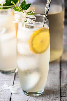 Honeysuckle Vodka Lemonade ~ this uniquely refreshing cocktail is make with homemade honeysuckle infused vodka and fresh squeezed lemonade!
