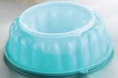 "Tupperware Jel Ring Mold by Tupperware. $12.00. Versatile favorite.   In addition to the beautiful gelatin-based desserts and salads you'll create, this versatile 6-cup/1.4 L mold can be used to shape a variety of cold meat, rice and pasta dishes. Or fill with juice and freeze to create a punch bowl ring! The removable center and top seals ensure safe, simple removal of all your molded masterpieces.  ? 9 1/8 x 3 1/8""/24 x 8cm.  ? Dishwasher safe."