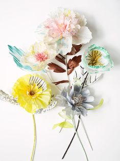 delight grouping of paper flowers ... all different styles ... mostly crepe paper ...