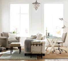 home office with chandelier and seating area glass top desk