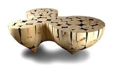 I ran across these amazing wooden tables from Korean Lee Jae-Hyo and thought you just had to see them too.