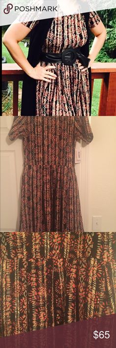 Lularoe Amelia Dress This is a Lularoe dress in a size medium. It is brand new with tags and it's beautiful! The Amelia dress is so flattering and it has pockets! LuLaRoe Dresses