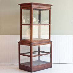 I usually dislike most glass cabinets or curios but this one is simple, elegant and versitle