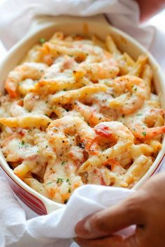 Weight Loss Cutting Calories Skinny Shrimp Alfredo Pasta Bake - An unbelievably cheesy, creamy lightened-up pasta bake that you can easily make ahead of time! - An unbelievably cheesy, creamy lightened-up pasta bake that you can easily make ahead of time! Pastas Recipes, Fish Recipes, Seafood Recipes, Cooking Recipes, Top Recipes, Baked Pasta Recipes, Recipes With Shrimp, Shrimp Dinner Recipes, Healthy Shrimp Recipes