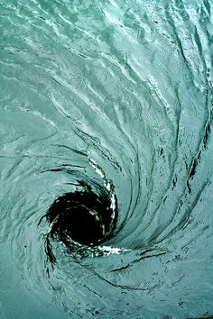 Down he fell into the sunken black hole of raging white water. But he didn't fight the current. He had to save Iriana.