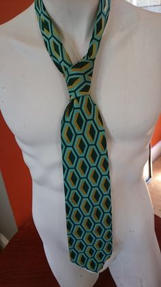 Check out this item in my Etsy shop https://www.etsy.com/listing/463406116/vintage-1970s-wide-tie-geometric-pattern