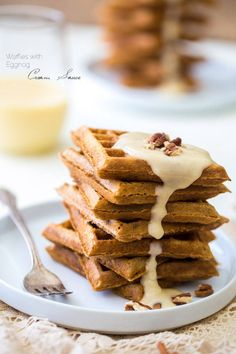 The Best Waffles with Eggnog Cream Sauce - Seriously. These are absolutely AMAZING! Light, crispy and perfect for Christmas morning! | Foodfaithfitness.com | #recipe