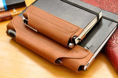 The Quiver pen holder for Moleskine, Rhodia, Leuchtturm, and other similar notebooks.