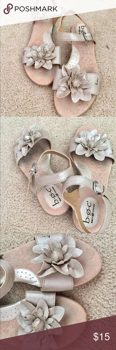 Gold Flower Sandals Strappy gold sandals with a cute flower embellishment. Great shape. b.o.c. Shoes Sandals