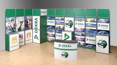 """Check out this custom Flexiframe exhibit for Dekra (Spain). In this exhibit, ideal for a 10' x 20' trade show exhibit space, notice several unique features: corner tower construction, 3 attached counters with """"hide-it"""" front entry access to hidden shelves which add work surfaces, storage and extra stability, and an elegant SnapUp MidiReception counter. With the addition of product & service focused rigid panel graphics, Dekra is show ready. See www.markbricdisplay.com or call 800-742-6275"""