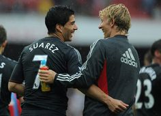 Luis Suarez and Dirk Kuyt of Liverpool share a joke as they celebrate victory after the Barclays Premier League match between Arsenal and Liverpool at the Emirates Stadium on August 20, 2011 in London, England.