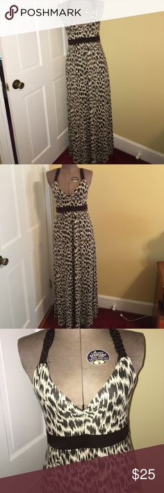 Banana Republic Maxi Dress XS Brown Cream Tribal Beautiful Long Maxi Dress Halter Racerback Style Back by Banana Republic Size XS. Only thing is the fabric label missing but I assume Cotton Stretch. 1 of the strands to the braided tie has come loose. Other than that Almost Brand New without Tags Beauty! Perfect for travelling! Thanks for viewing & Sharing / Smoke Free Home Banana Republic Dresses Maxi