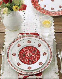 Bandanna Table Setting:     A humble picnic table can be set with as much care as your fine dining table. Dress up a wooden picnic table with an embroidered cotton or lace runner, and use a few strategically placed bowls and plates, like these bandanna-print ones, to anchor the cloth.