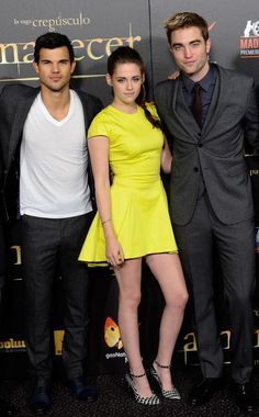 November 15, 2012: Kristen Stewart attended Madrid's Twilight Breaking Dawn: Part Two premiere in an acid yellow fit to flare dress by Christian Dior. She donned a pair of black and white print heels with a studded ankle strap by Barbara Bui. #neon #dior
